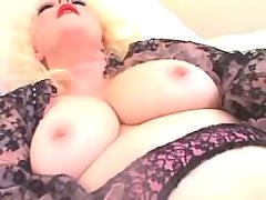 Chubby lady enjoys dildo