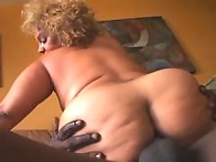 Chubby woman rides chocolate cock