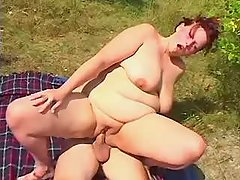 Chubby woman riding cock on picnic