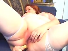 Fat mature caresses herself on sofa