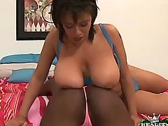 Busty ebony girls caress each other